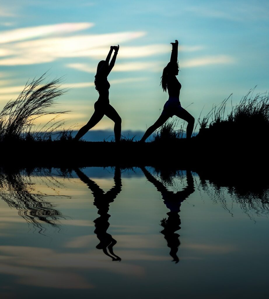 Lookalike audience represented by an image of the silhouette of twins doing yoga with their reflection in a pool of water